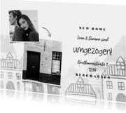 Umzugskarte mit Fotos und Häusern im Hintergrund