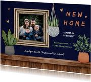 Umzugskarte 'new home' Foto in Rahmen und Pflanzen