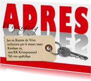 Verhuisbericht adreswijziging met sleutel en labeltje