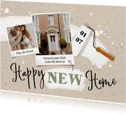 Verhuiskaart 'Happy new home' met verfroller en spetters