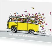 VW bus geel met bloemen