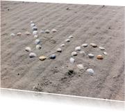 xje schelpen met zand