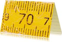 70 op oude gele duimstok