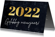 Eenvoudige nieuwjaarskaart met groot jaartal 2022 in goud