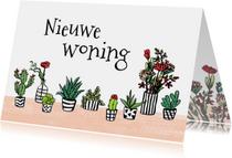 Felicitatie huis met plantjes en bloemen