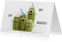 Grappige verjaardagskaart met cactussen met oogjes en feest
