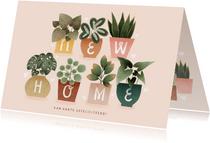 Hippe felicitatiekaart new home met plantjes en hartjes