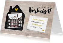 Hippe verhuiskaart met huisje, foto's en hout