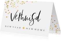 Kerst verhuiskaart met confetti en handgeschreven teksten