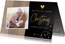Kerstkaart hout donker confetti goud foto
