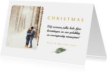 Kerstkaart met eigen foto en een groen takje