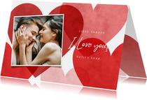 Lieve valentijnskaart met rode, roze hartjes en foto