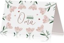 Moederdagkaart liefste oma met roze bloemen en hartjes