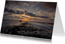 Mooie zon langs de kust