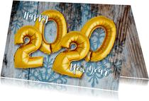 Nieuwjaarskaart ballon goud 2020 op hout