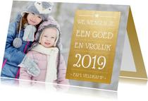 Nieuwjaarskaart met goudlook vlak en foto achtergrond