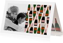 Stijlvolle nieuwjaarskaart met foto en champagneflessen