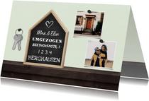 Umzugskarte mit Haus, Fotos und Schlüsseln