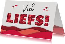 Valentijnskaart met paper cutout LIEFS met rode hartjes