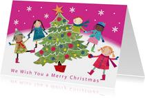 Vrolijke kerstkaart met kinderen dansend om een kerstboom