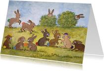 Vrolijke kinderkaart met spelende konijntjes