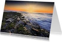 Zonsondergang langs de Noordzee