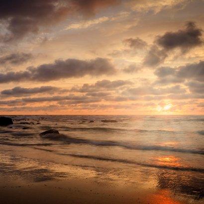 Bedankkaart na overlijden met foto van een ondergaande zon 2