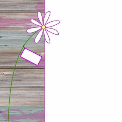 Giraffe met een grote bos bloemen 2