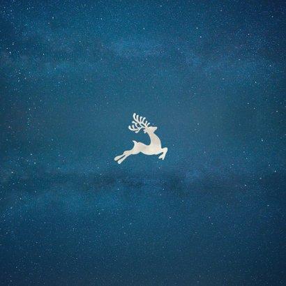 Originele kerstkaart met silhouet van een arrenslee in maan Achterkant