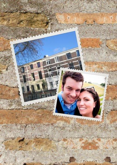 Umzugskarte mit Fotos auf einer Mauer 2