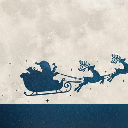 Zakelijke kerstkaart met silhouet van kerstman in arrenslee 2