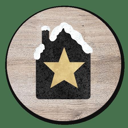 Huisje met sneeuw en gouden ster